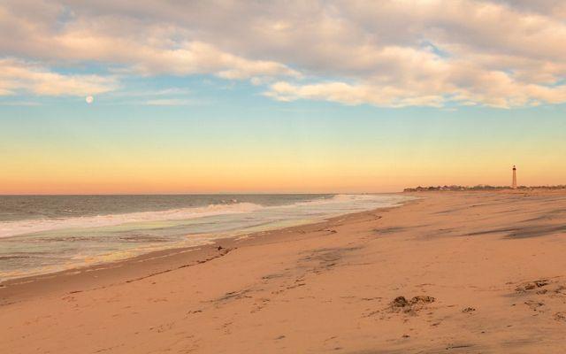 Beach with lighthouse.