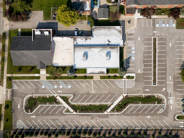 View from directly above showing a parking lot with more plantings between the rows of spots.