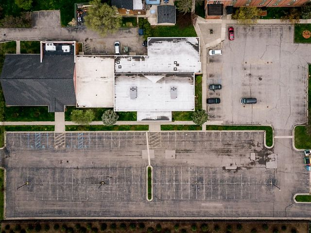 View from directly above showing a parking lot without plantings or trees.