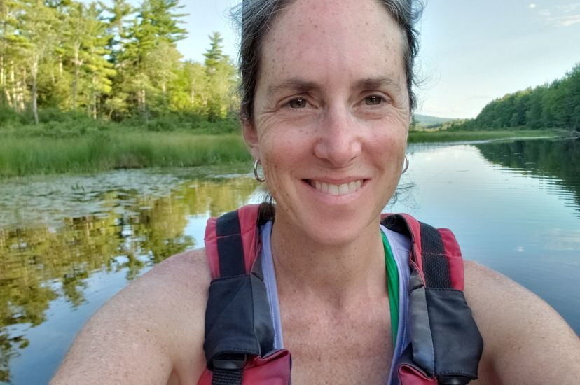 Samantha Horn, Director of Science for TNC in Maine, kayaks on Hopkins Stream in Maine, where she looks for turtles, fish, and birds.
