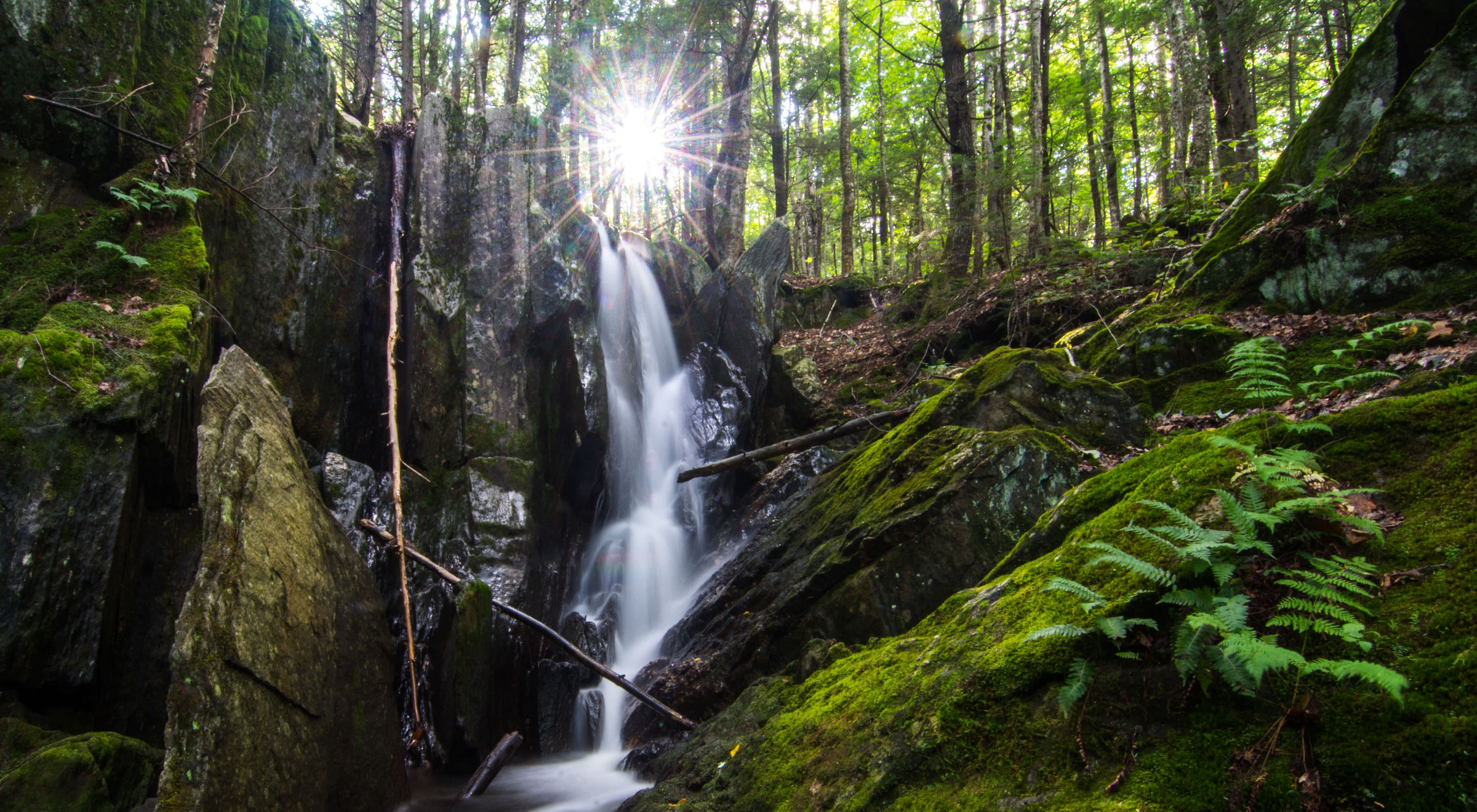 A waterfall flows along Sculptured Rocks Road in Groton, New Hampshire near Kimball Hill Forest
