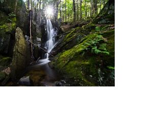 A waterfall flows along Sculptured Rocks Road in Groton, New Hampshire near Kimball Hill Forest.