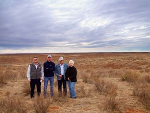 Group on mixed grass prairie landscape.