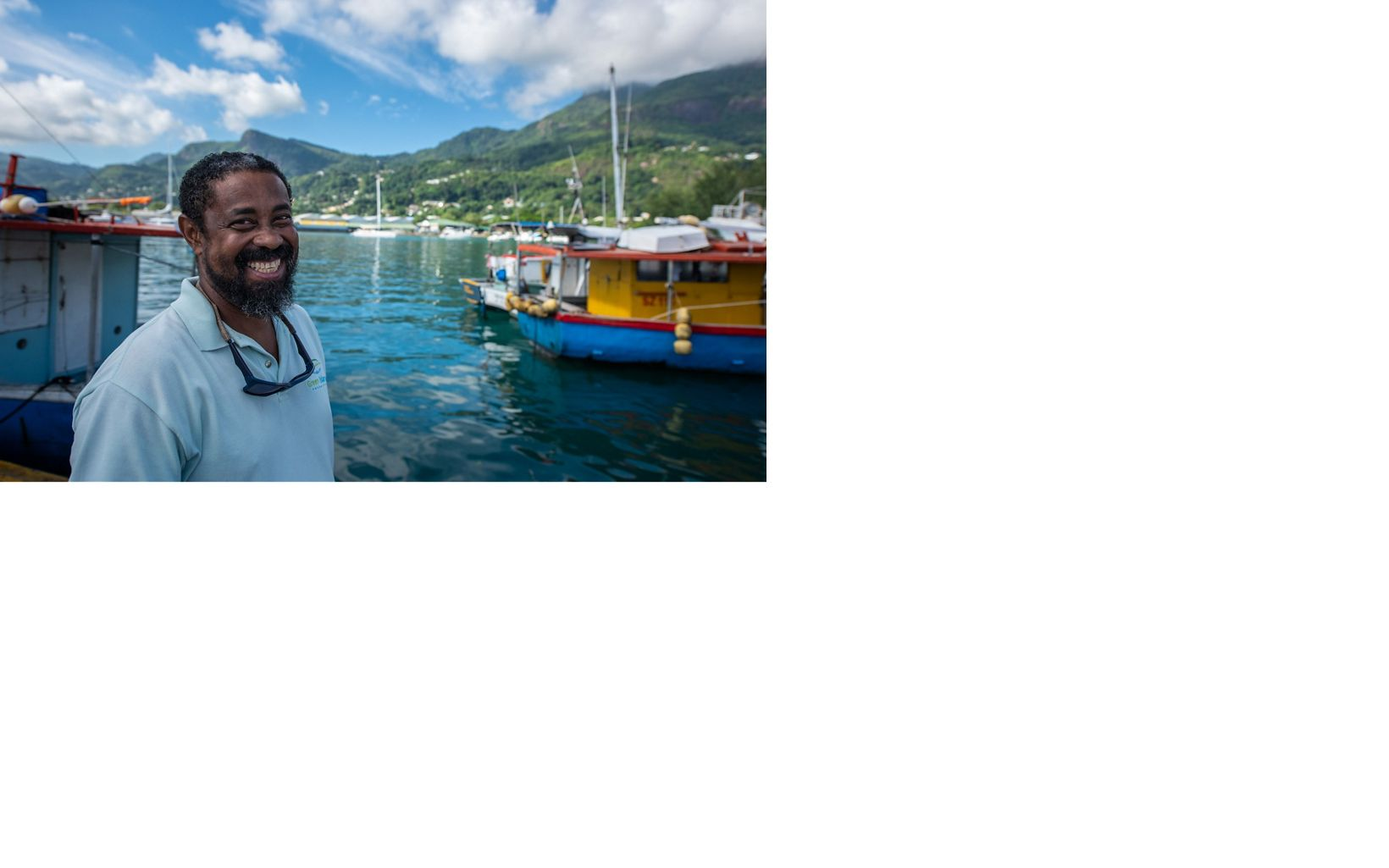 man in front of boats