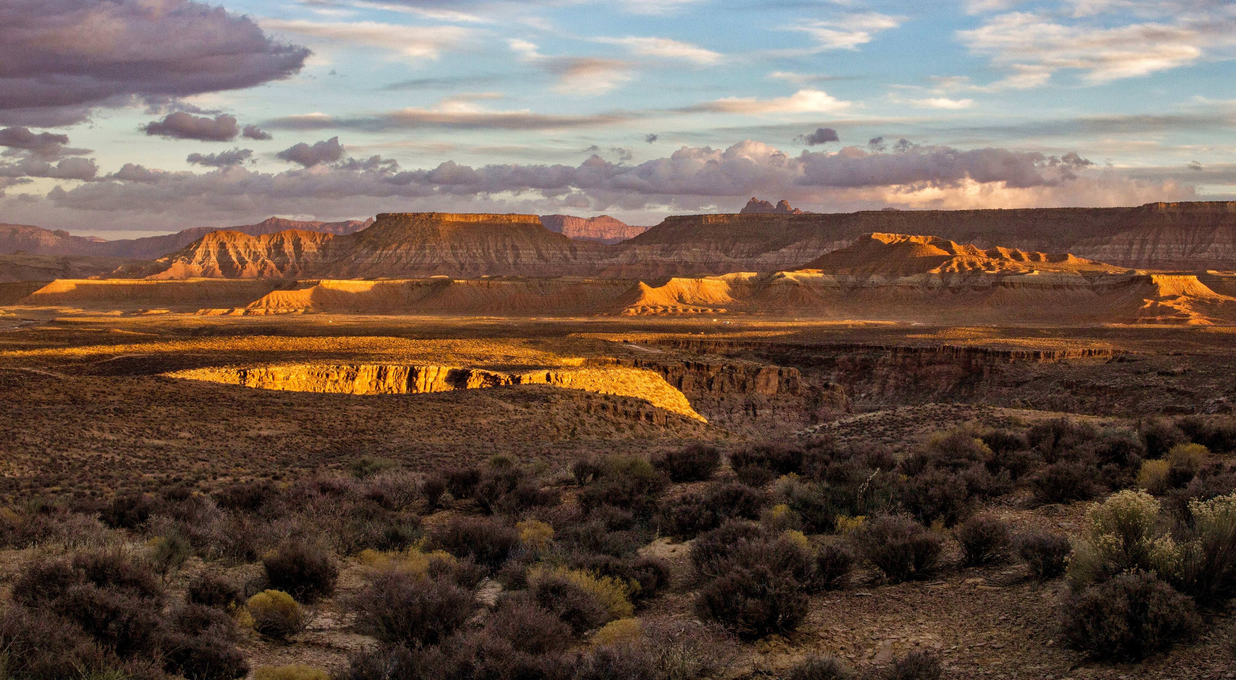 Late afternoon panorama view of rocky outcroppings.
