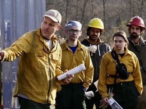 Gabe Cahalan leads the morning burn brief prior to the start of a controlled burn at Maryland's Sideling Hill Creek Preserve, November, 2019.
