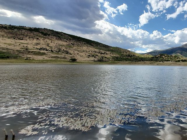 Clouds reflect off a body of water during a bright day at Silver Mountain Ranch.