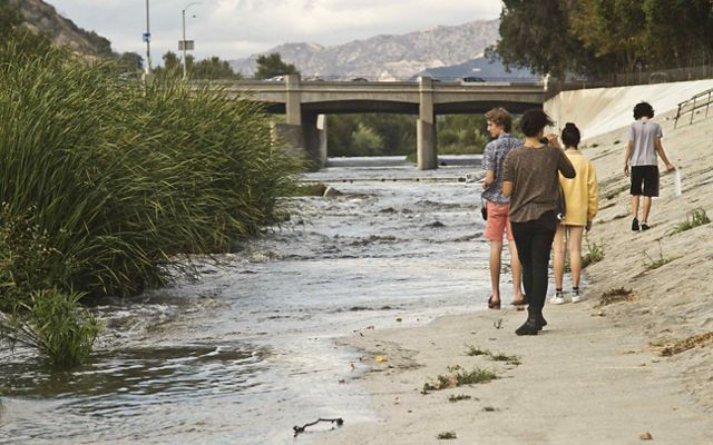 Students walking along the LA River.
