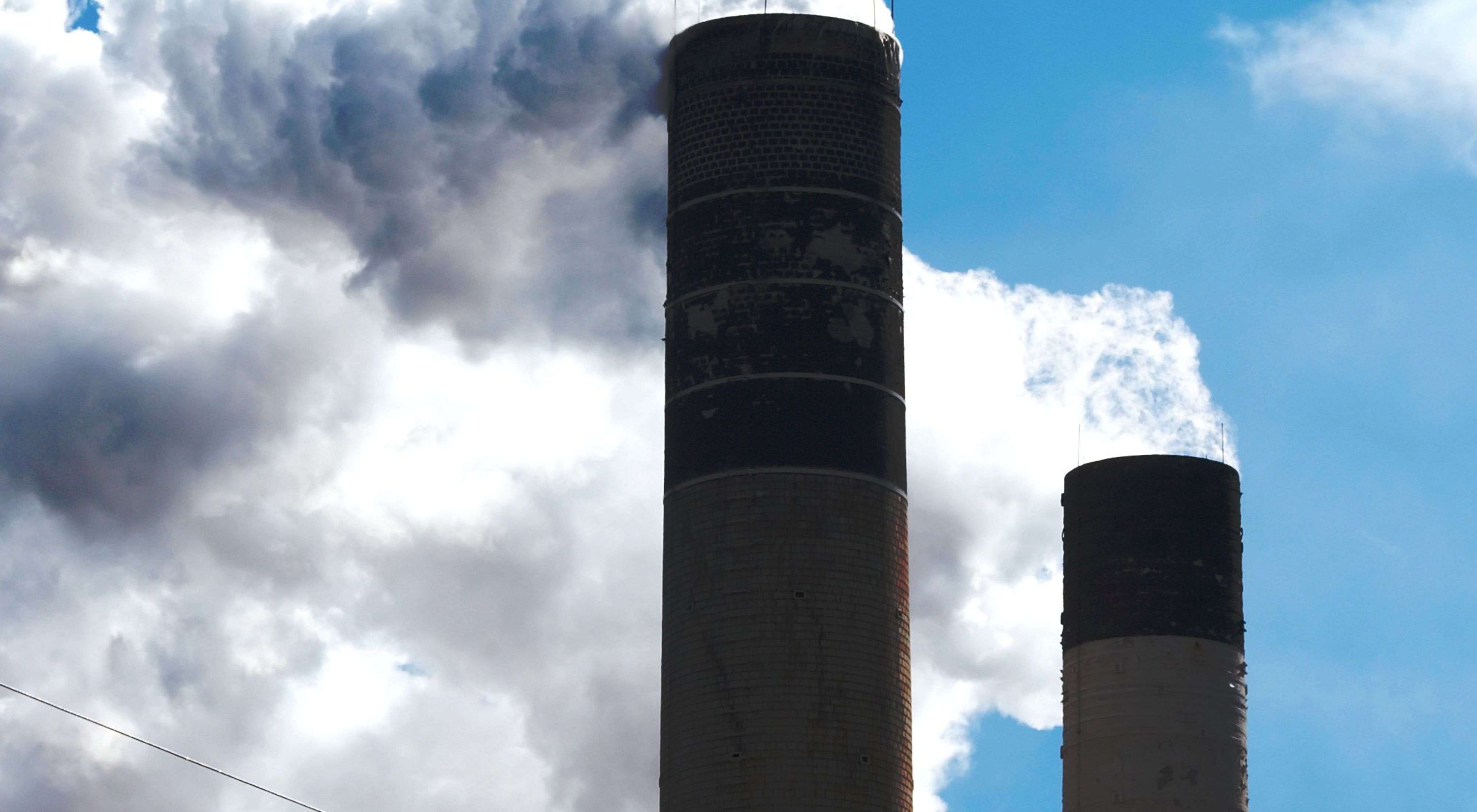 Photo of air pollution coming out of a smokestack.