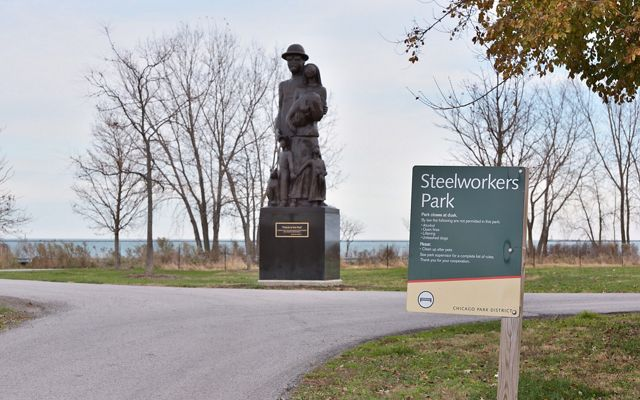 A statue sits next to a pathway at Chicago's Steelworkers Park.