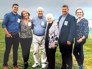 Six members of the Strasburger family in a field.