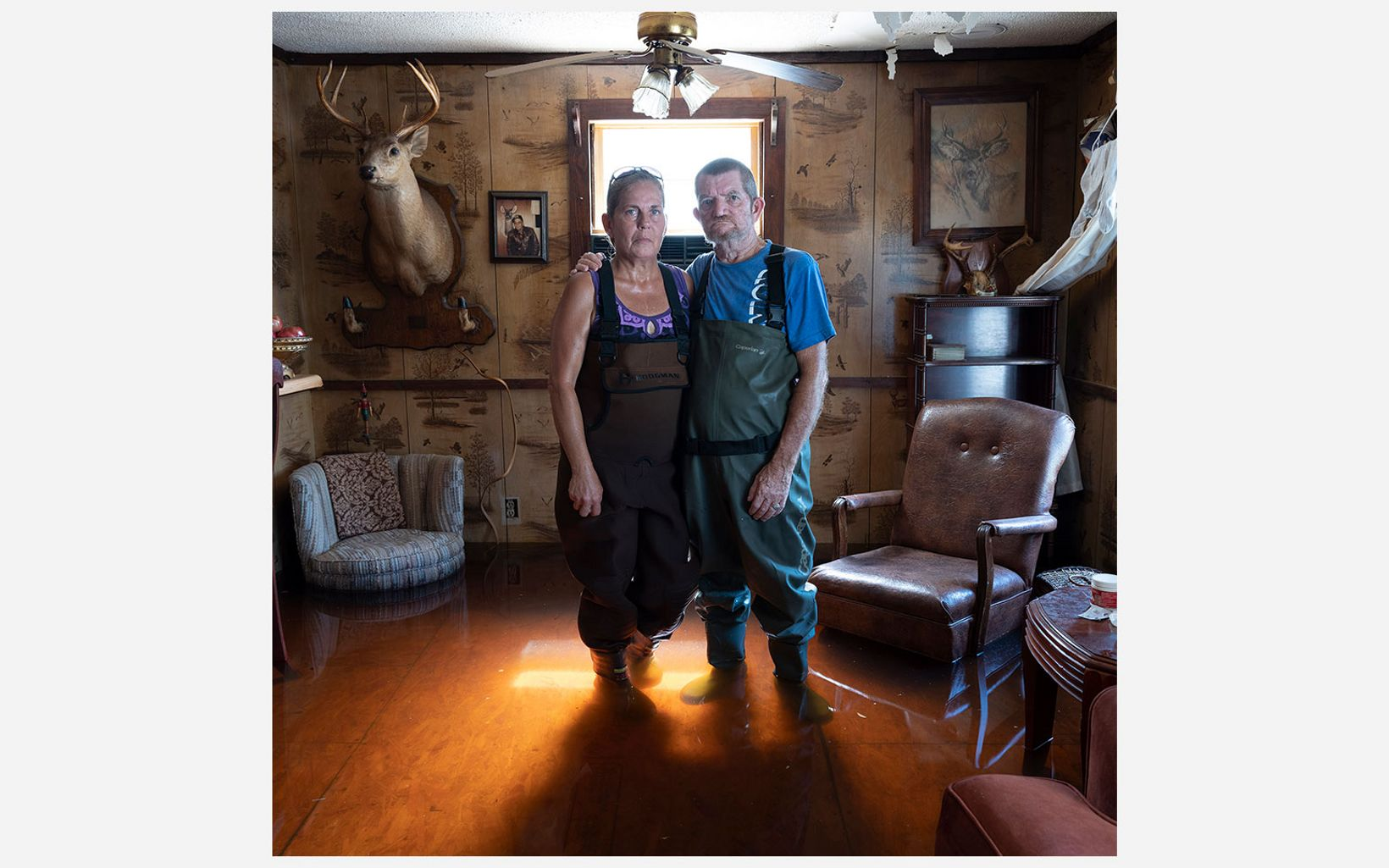 Kimberly and Rudy Fralix stand in their flooded home