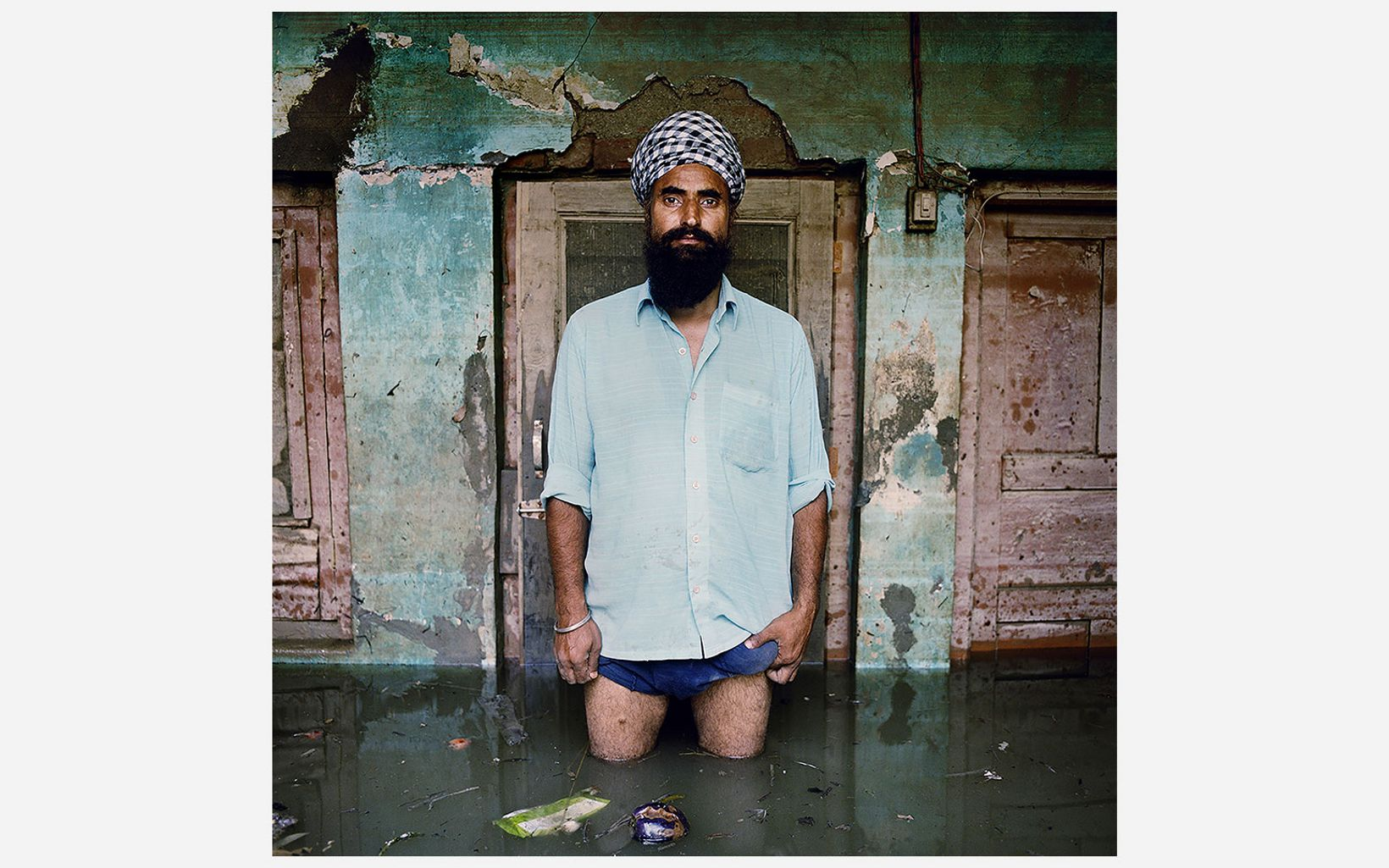 J.B. Singh stands in water deeper than his knees in Kashmir, India