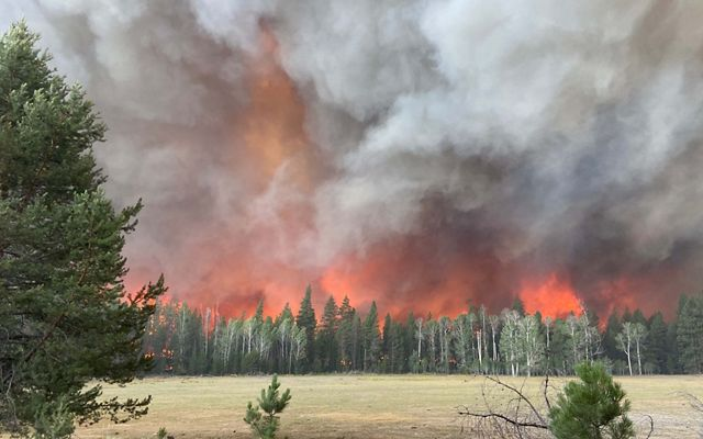 Flames from the Bootleg Fire threaten Sycan Marsh Preserve.