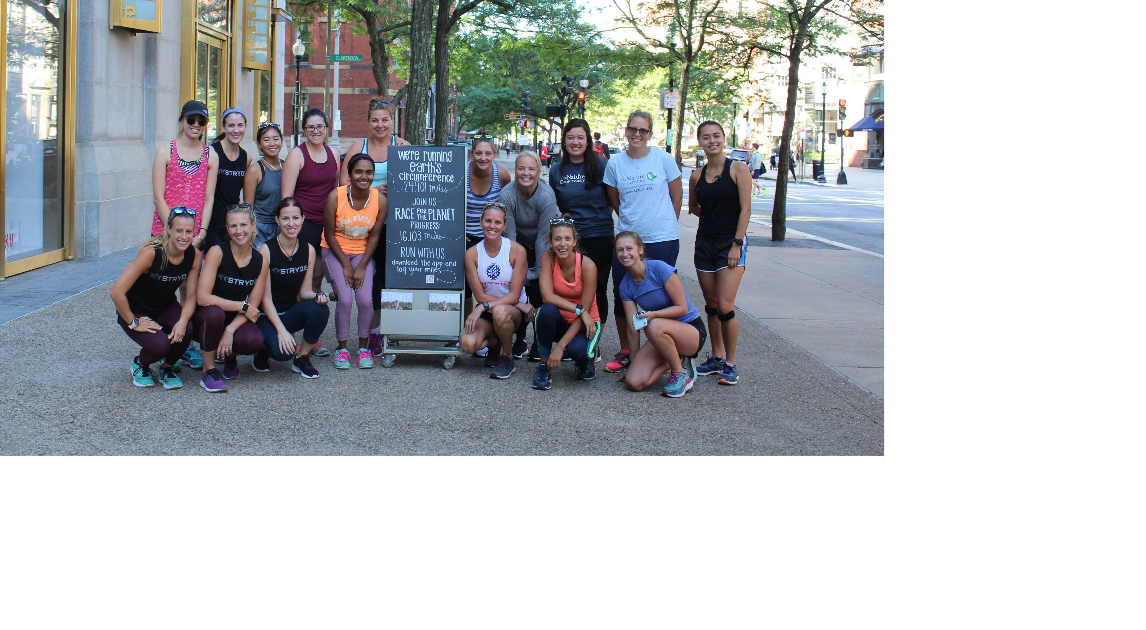 """TNC and Athleta teamed up in 2019 to """"Race for the Planet,"""" holding events at local stores, like this one in Boston. Trenni Kusnierek is pictured at the center."""