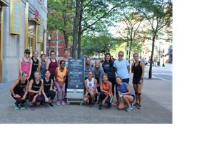 "TNC and Athleta teamed up in 2019 to ""Race for the Planet,"" holding events at local stores, like this one in Boston. Trenni Kusnierek is pictured at the center."