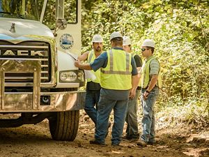 workers in the Arkansas Unpaved Roads Program