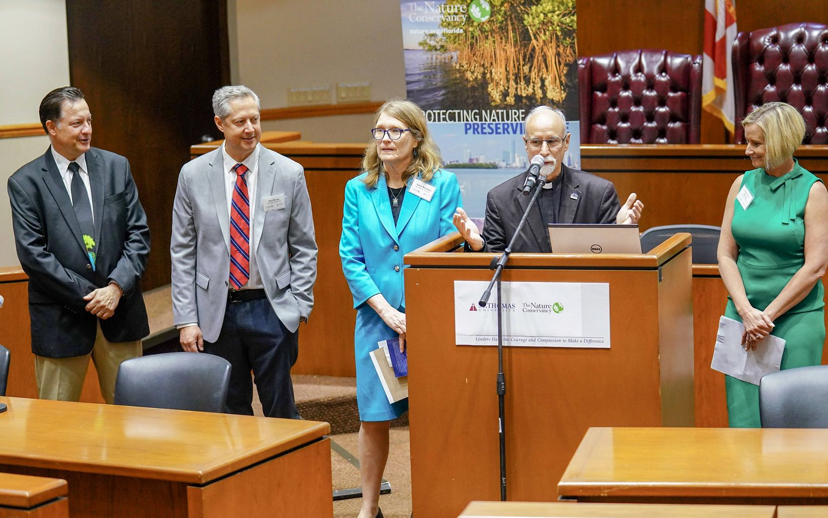 introduces the panel (from left): STU Law Professor Keith Rizzardi, TNC Climate Mgr. Rod Braun, TNC Policy Advisor Janet Bowman, TNC FL Executive Director Temperince Morgan