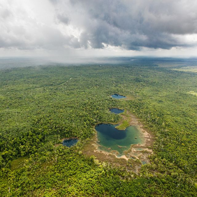 An aerial view of the Cara Blanca Pools in Belize's Maya Forest