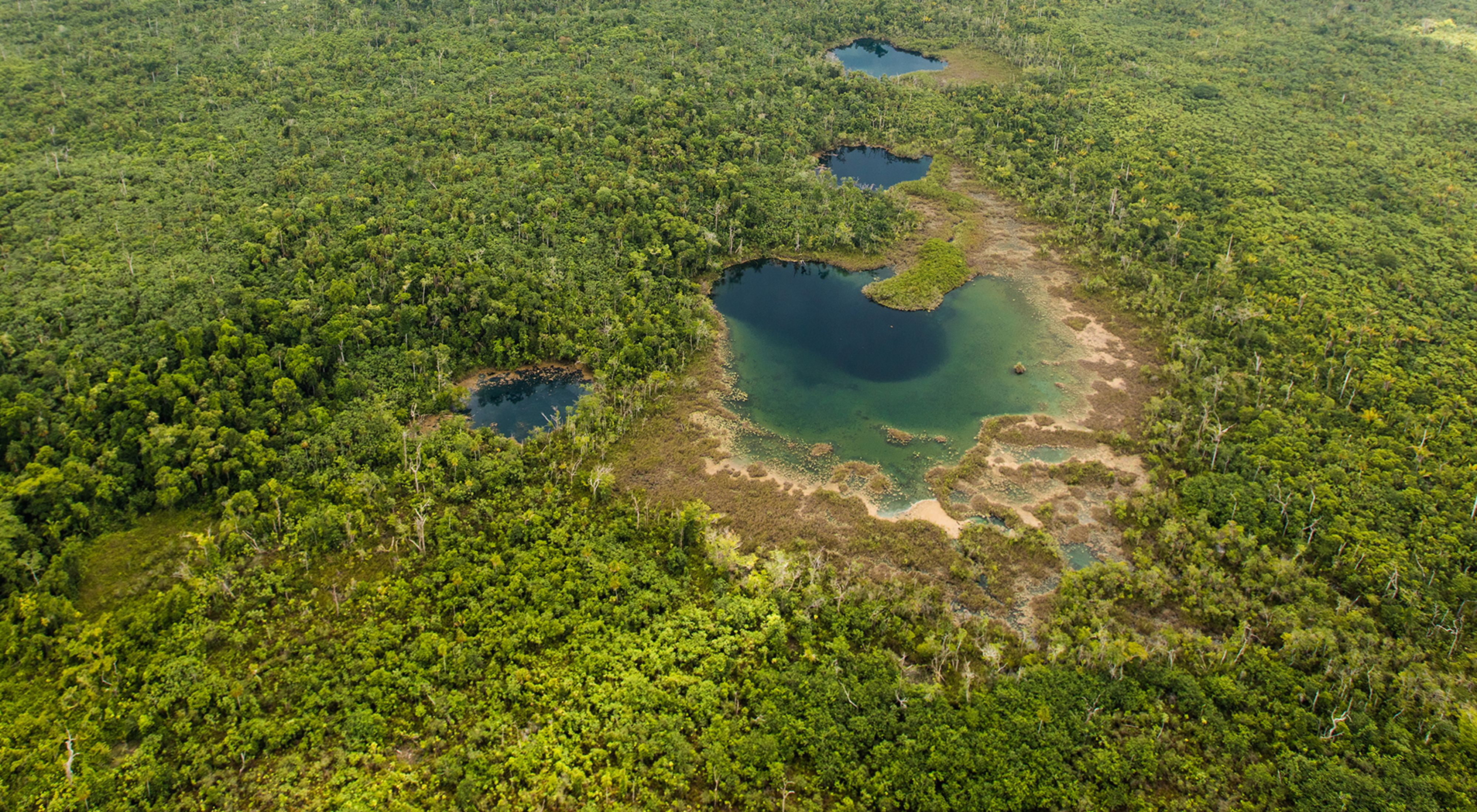 An aerial view of the Cara Blanca Pools 16, 17, 18, 19 in Belize's Maya Forest
