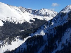 Snow-covered moutains against blue sky.