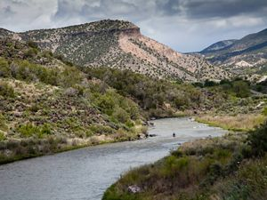 The Rio Grande river with a kayaker in the distance.