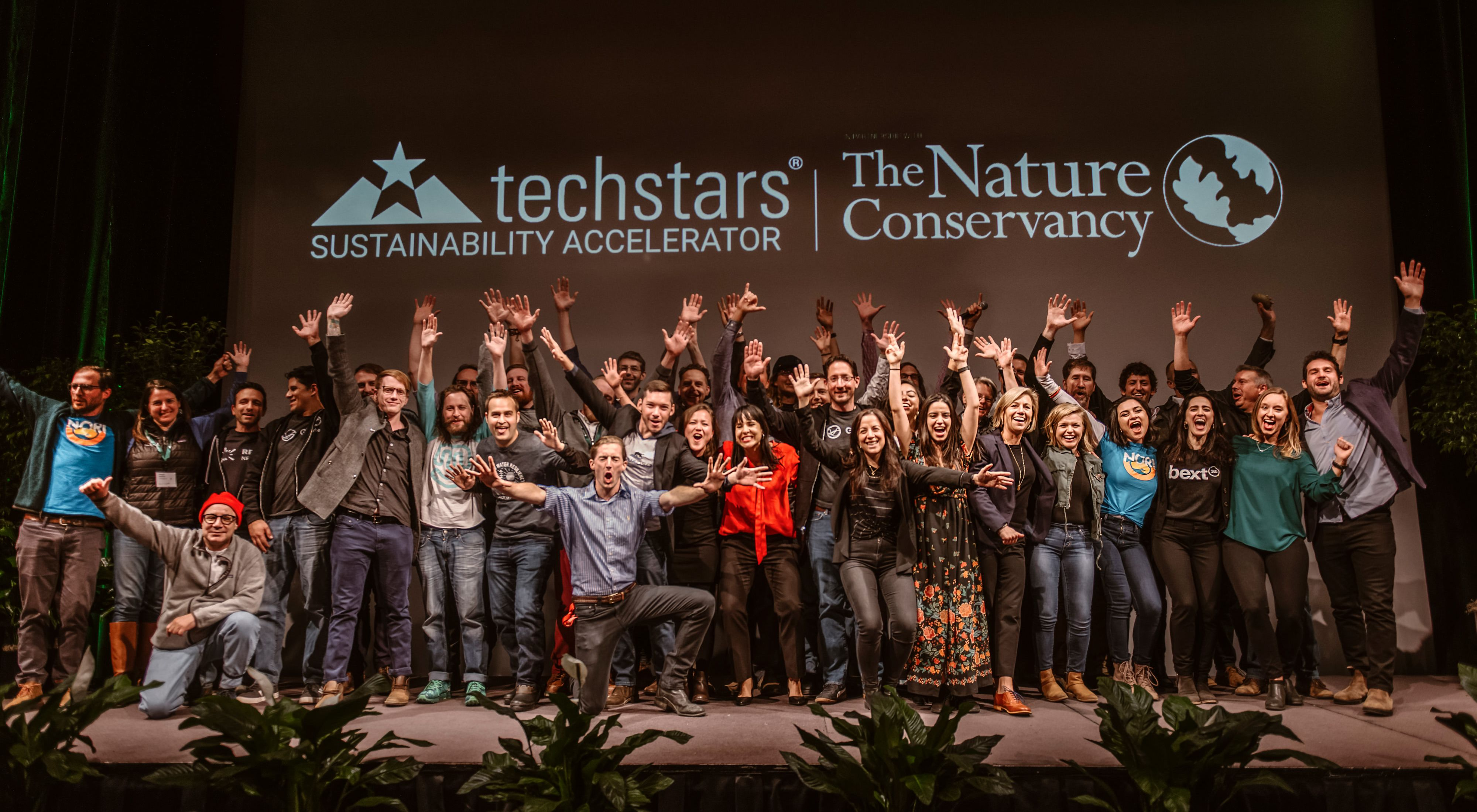 group photo of the 10 startups in the sustainability accelerator at 2019 demo day