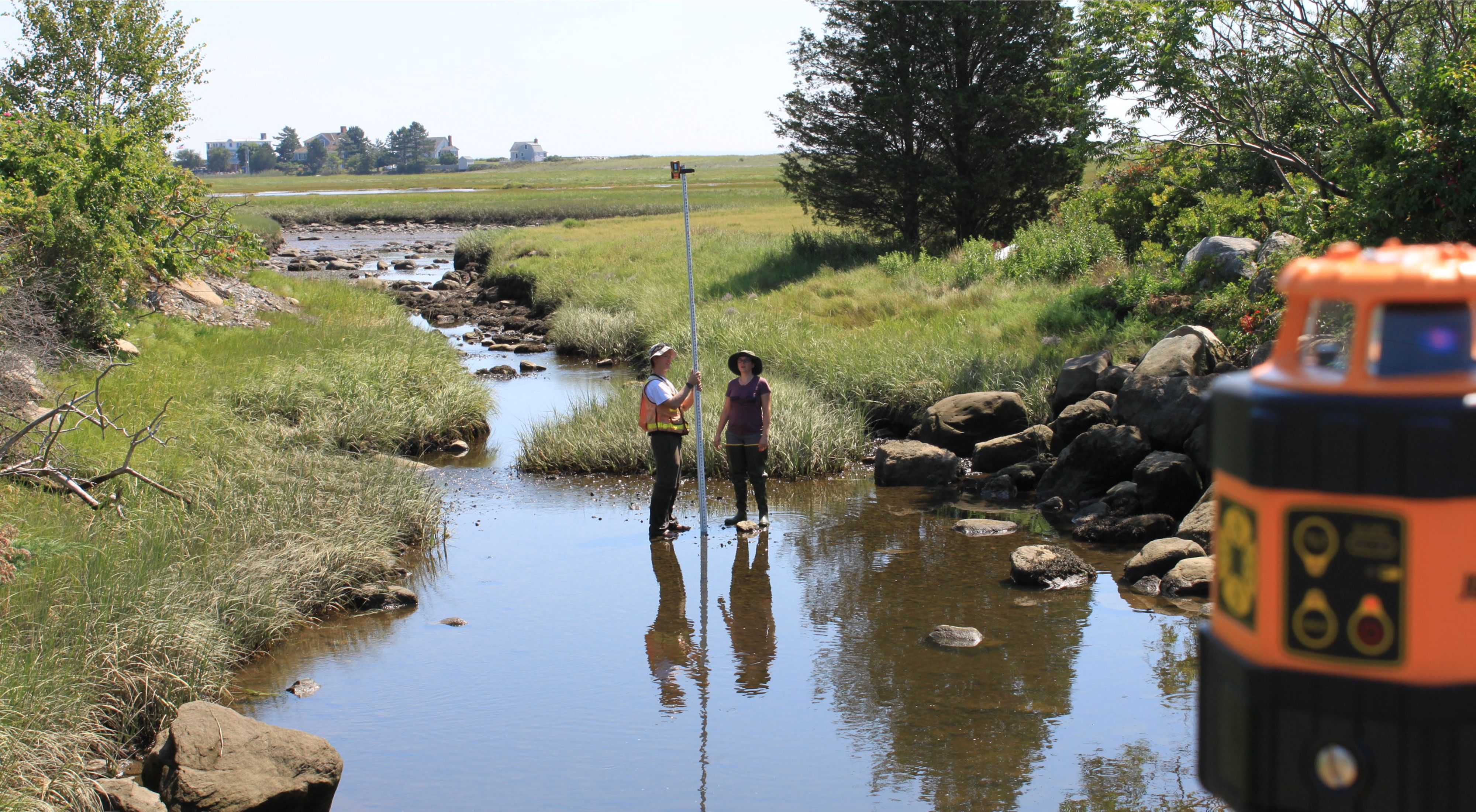 Scientists take measurements at a tidal culvert in Rye, New Hampshire