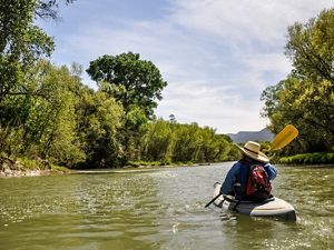 A kayaker paddles near Camp Verde.