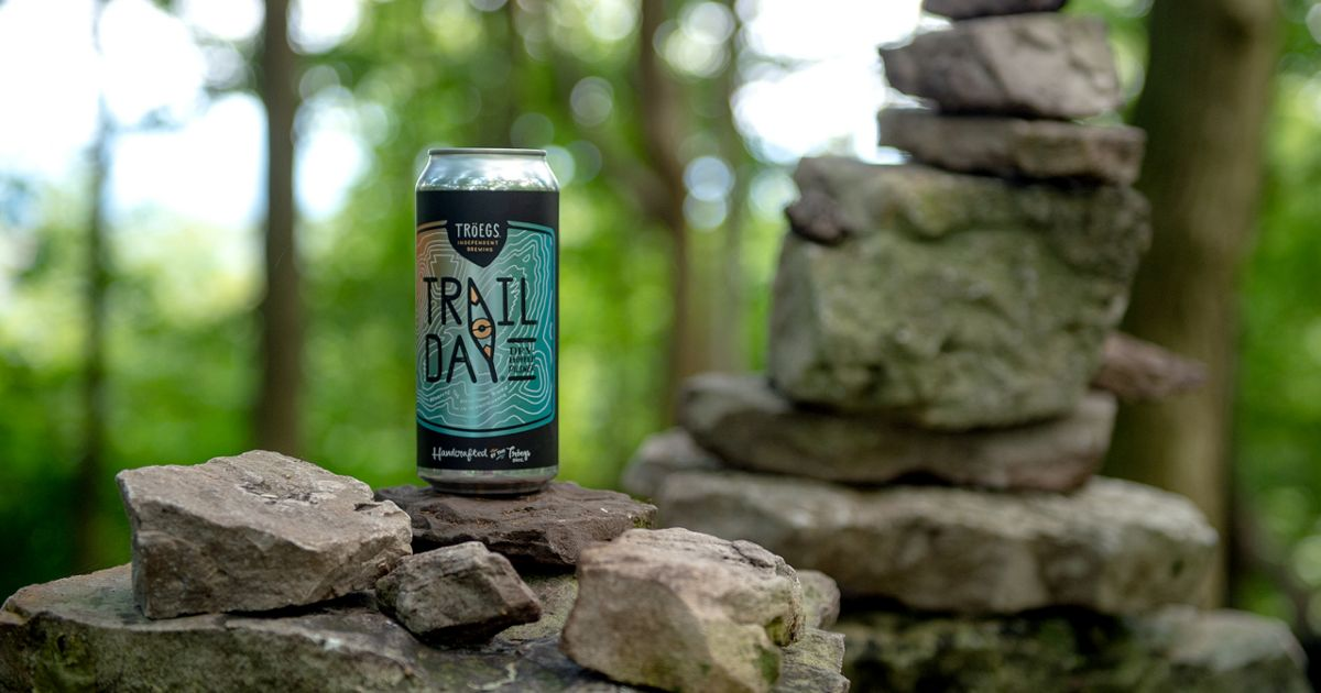 Beer can sitting on a rock wall