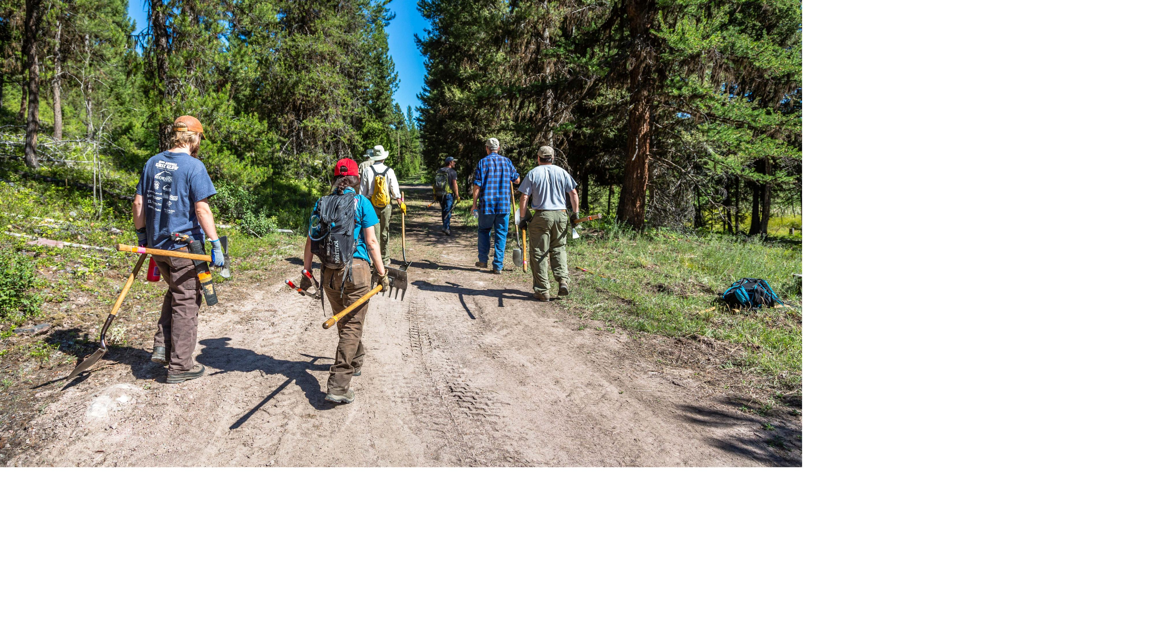 Volunteers spruce up trails at Tupper Lake.