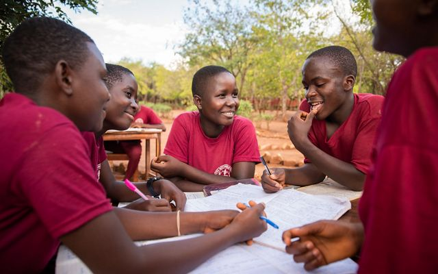 Teresia Gabriel studies with her classmates outside their dormitory at Lagosa Secondary School in the Tuungane Project area.