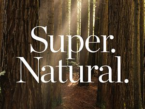 Tree trunks with text reading 'Super Natural.'