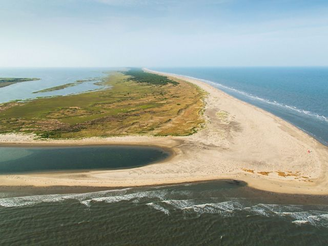 Aerial view of Hog Island looking down on a large stretch of sand extending into the Atlantic Ocean