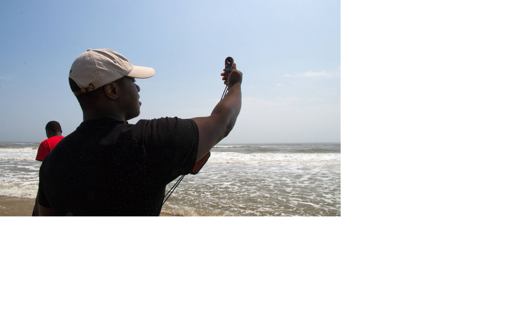 Carlton Smith, a student at Northampton High School, takes measurements on the beach at Parramore Island.