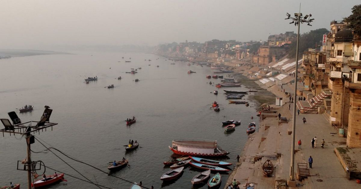 Indian city of Varanasi alongside the Ganges River busy with boats