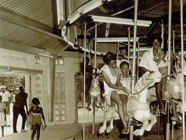 Historical photo of families and children riding the carousel at Virginia Key Beach.