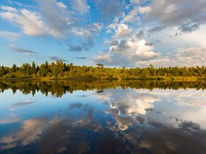 Reflection of clouds on Mink River