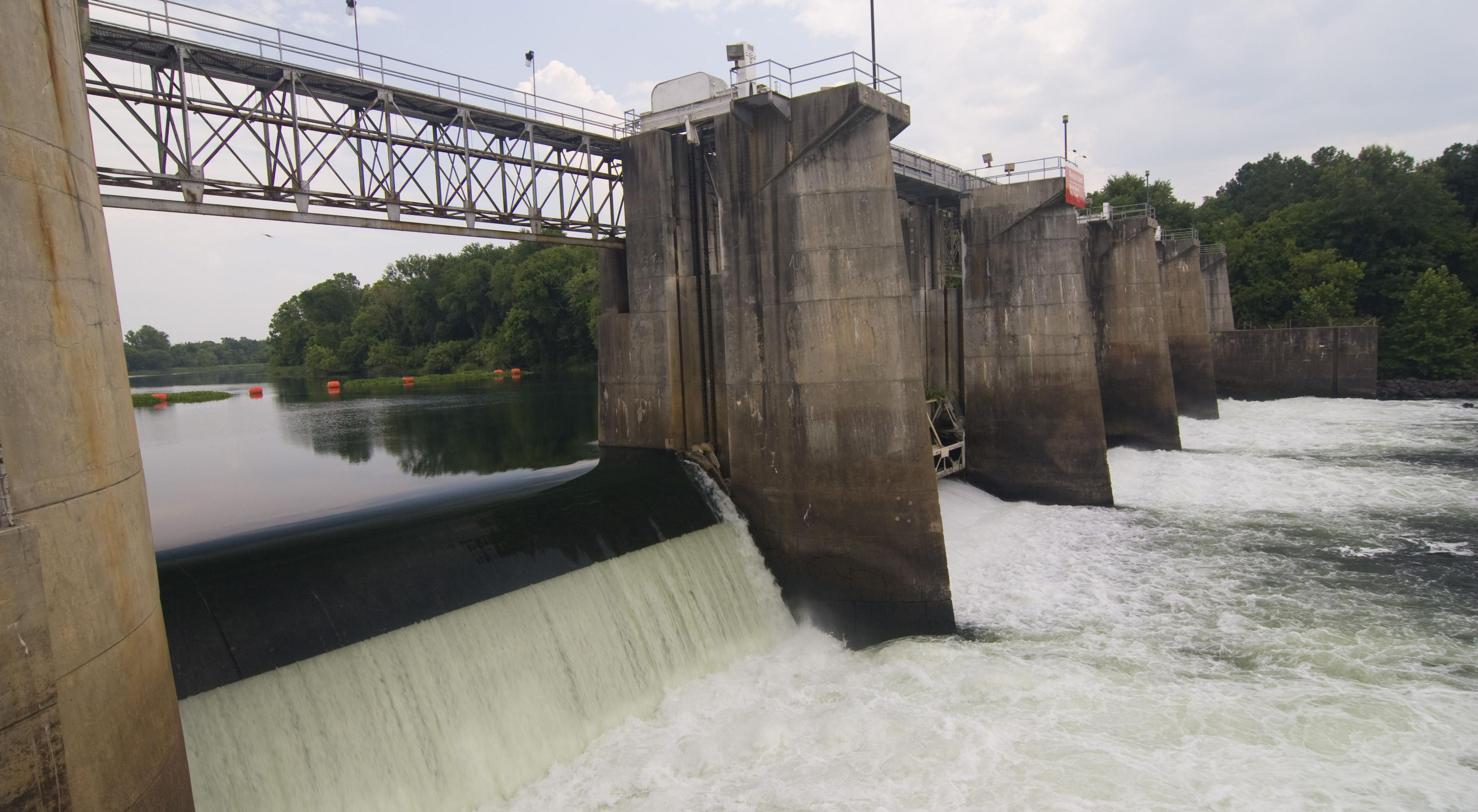 Photo of water flowing over a dam.