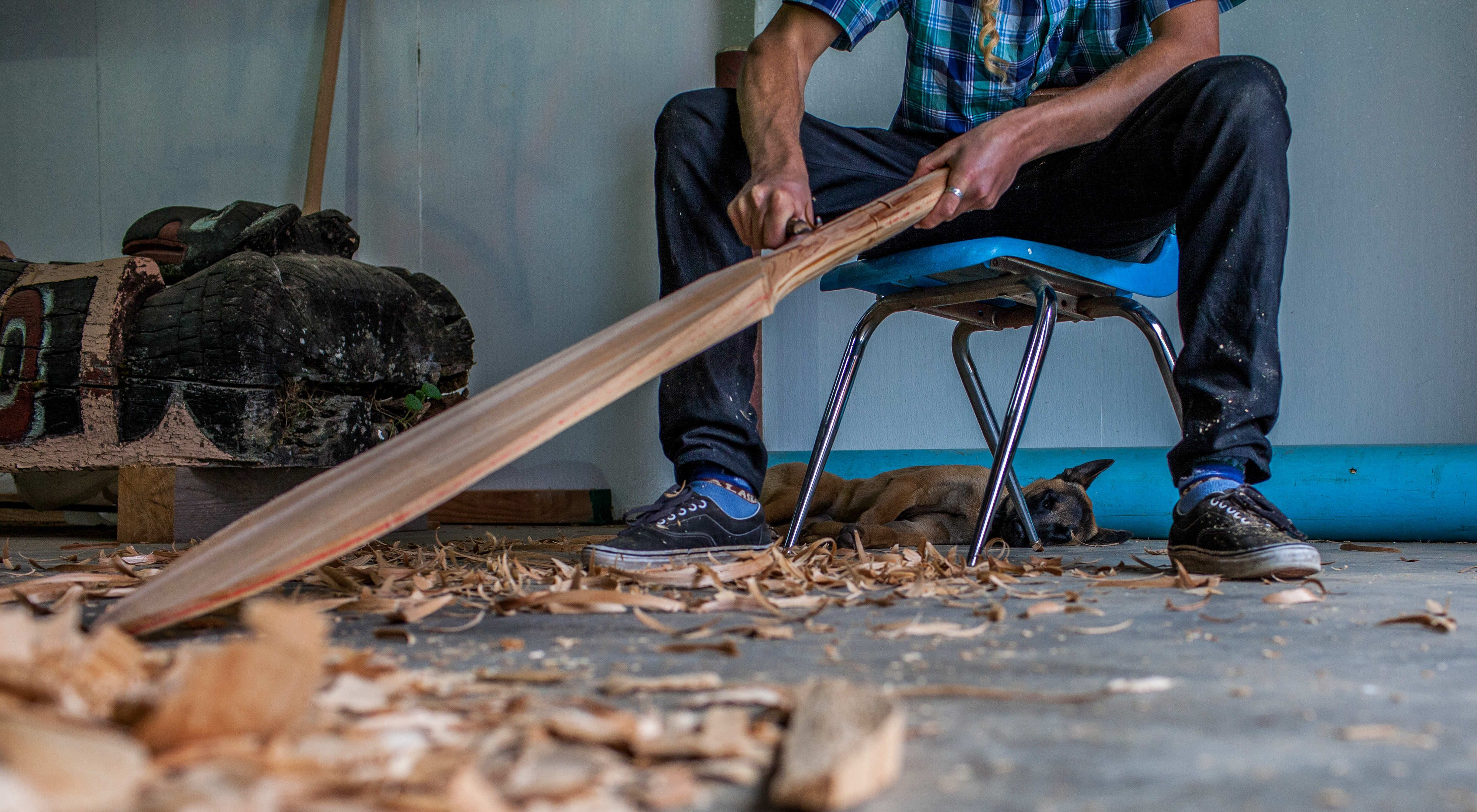 Carving a canoe paddle by hand