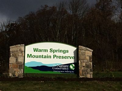 A sign welcomes visitors to Warm Springs Mountain.
