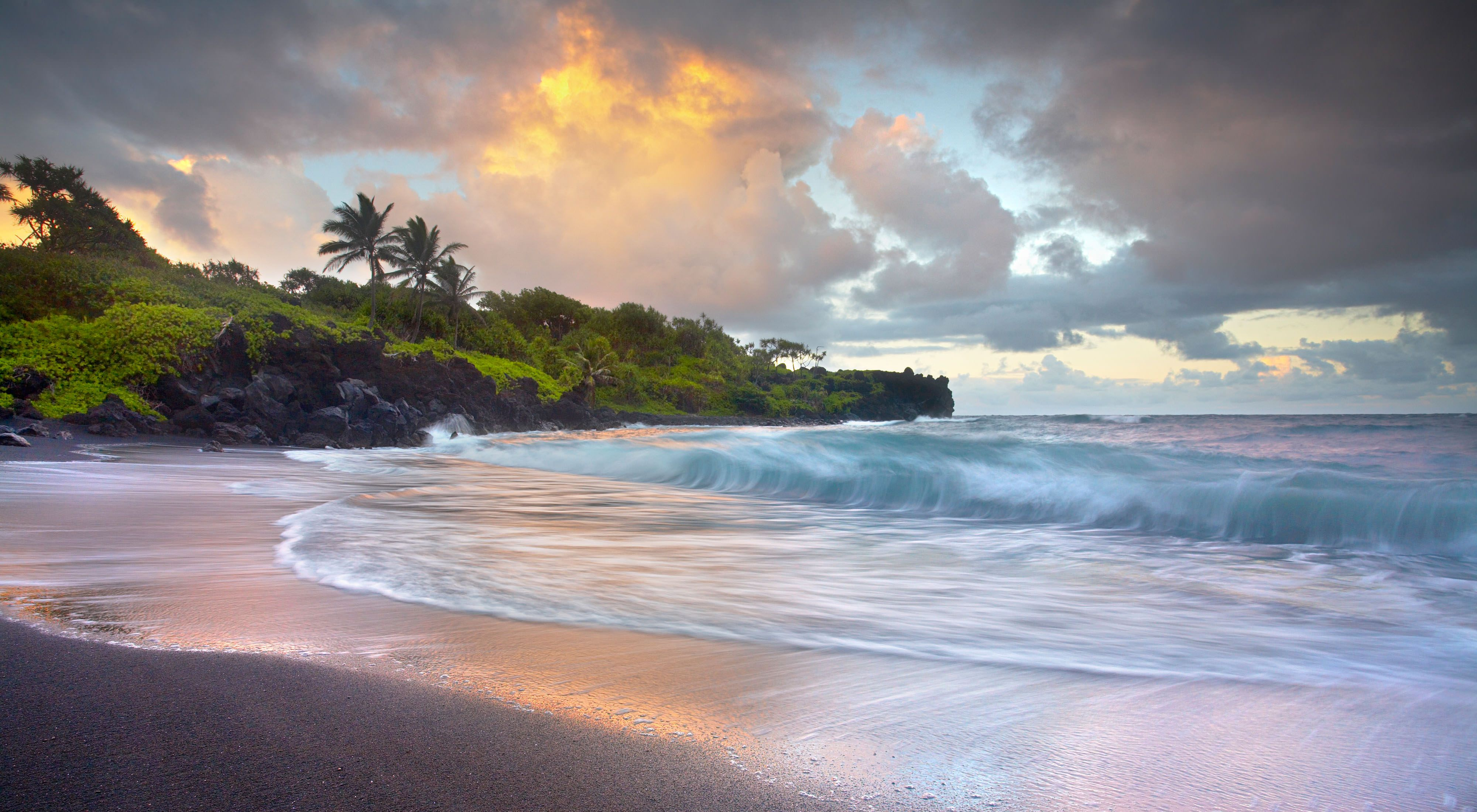 The black sand beach of Waianapanapa Sands near Hana, Maui in the Hawaiian islands.