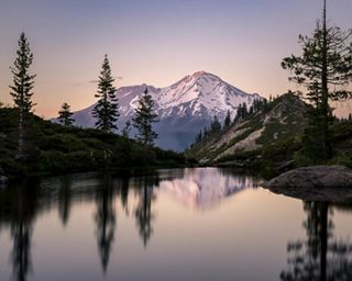 Mt. Shasta reflecting in Heart Lake during sunset.