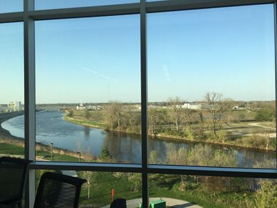 The view of a river and trees from an office window.