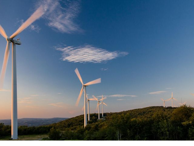 Wind farm turbines situated on a ridge top in the Appalachian mountains of West Virginia.