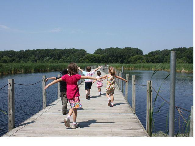 Kids running along the boardwalk at Wood Lake Nature Center