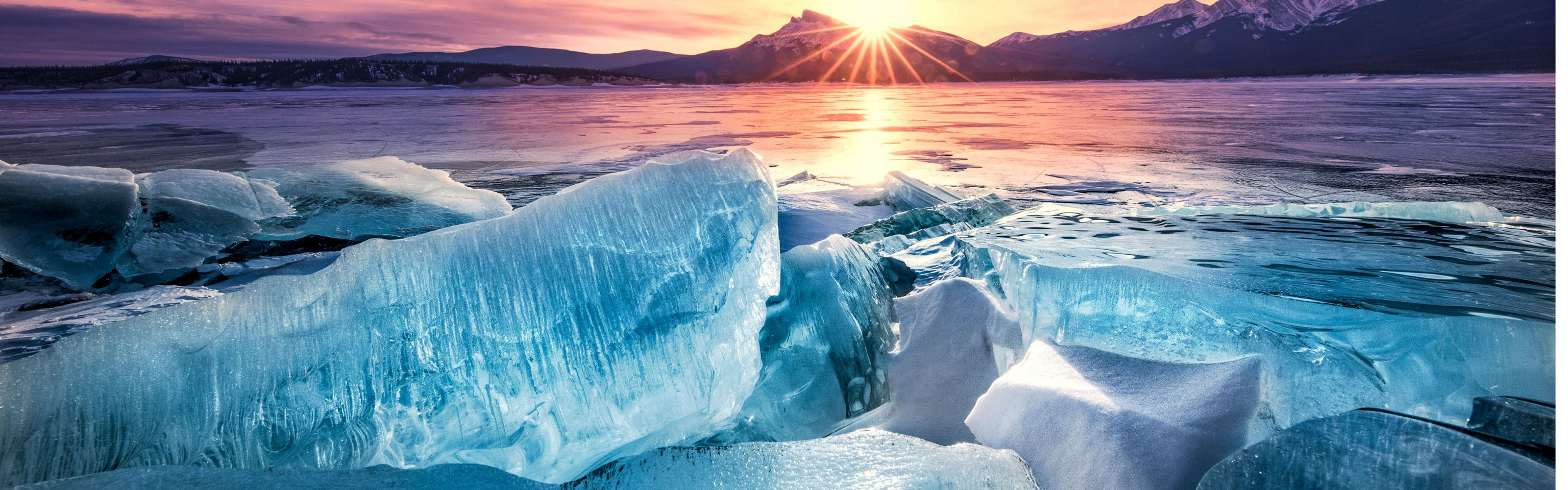 Ice breaks at dawn at Abraham Lake in Alberta, Canada. This photo was entered into The Nature Conservancy's 2018 Photo Contest.