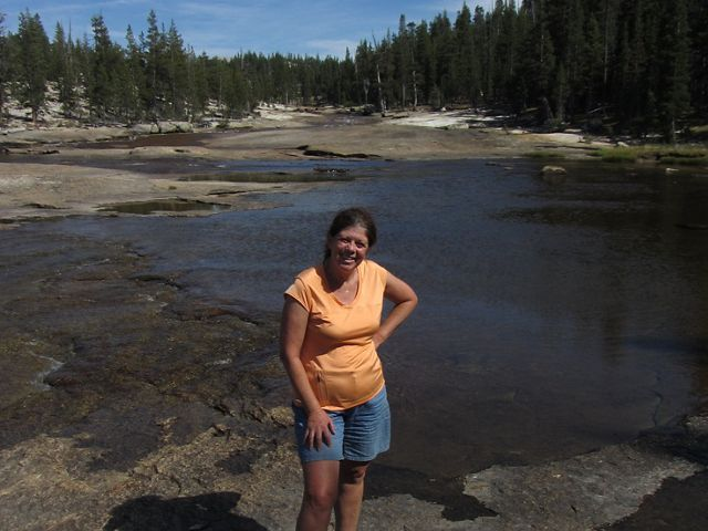 Francie Mitchell standing in front of a wide river.