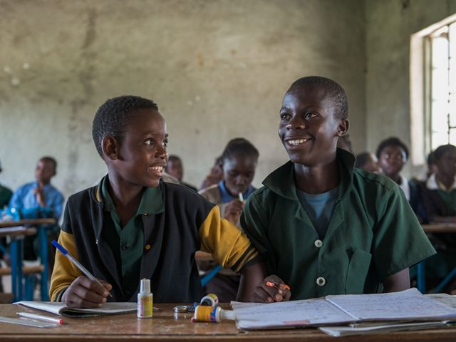 Two boys at a desk in their classroom