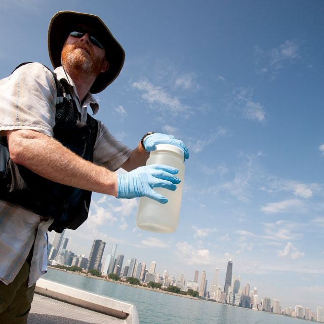 A scientists takes water samples on Lake Michigan